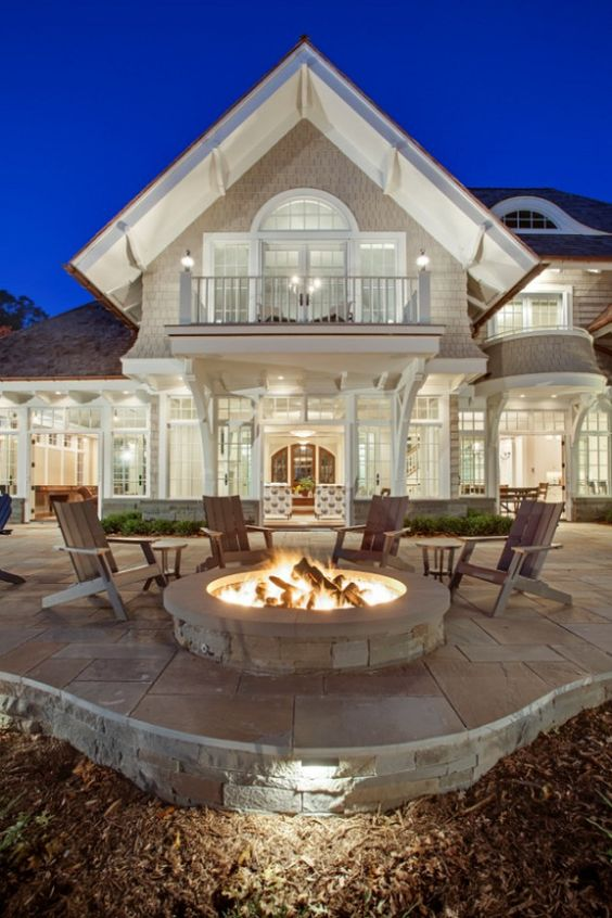 Fire pit. Coastal home with fire pit. John Kraemer & Sons.: