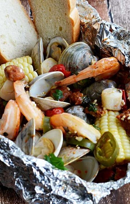 ... shrimp, clams, scallops, chorizo sausage (but I use turkey), corn, and