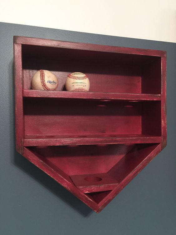 Build your baseball star a baseball holder for all his game balls! Keep the theme going by shaping it like home base. @katiebower makes it easy for you with this great tutorial on how to make it.Stain it with Varathane Wood Stain in your favorite color and be sure to protect it with a polyurethane such as Triple Thick. http://www.rustoleum.com/product-catalog/consumer-brands/varathane/triple-thick-polyurethane/