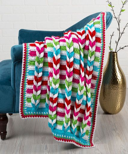 Pulled Taffy Blanket - free crochet pattern in two sizes by Marly Bird for Red Heart. Aran weight.
