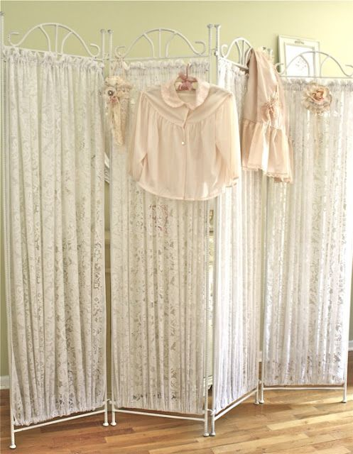 Shabby folding screen with lace panels: