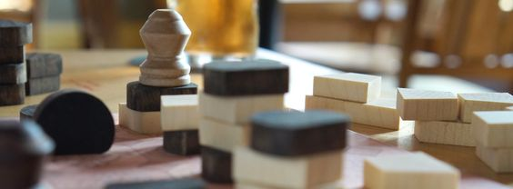 A game of Tak in a mid-game state.