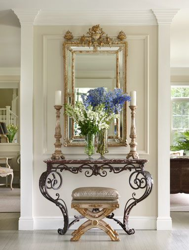 Entry Foyer With Fireplace : A mirror demi lune or some type of pieces shown and