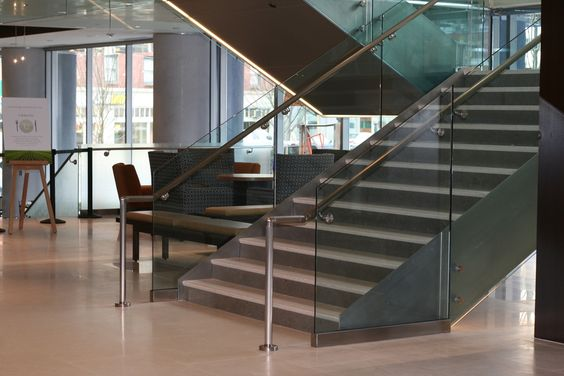 Stairs in the lobby leading to upper conference halls in a combination of Polished Lagos Azul and Polished Porto Beige LImestone - www.antonyarchitecturalstone.com