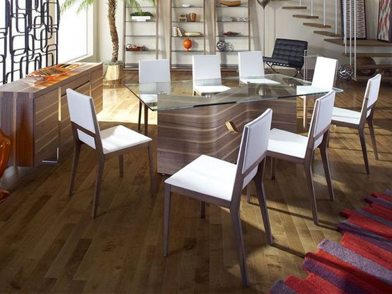 This chic, contemporary dining table features a wavy walnut base, topped by rectangular tempered glass -- a truly eye-catching and multifunctional centerpiece. | Dakota Dining Table cort.com