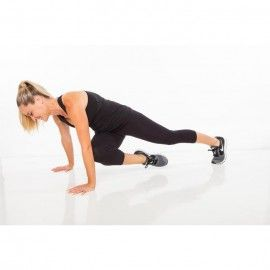 Begin in plank position with feet hip-width apart. Bend one knee across to opposite elbow (tapping knee to arm if possible), then quickly jump to switch legs.