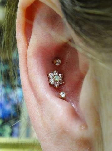 Triple Crystal Flower Conch Piercing Jewelry at MyBodiArt