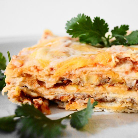 Mexican lasagna is loaded with big flavors and is perfect for game day. Layers of beef, cheese, salsa and tortillas make a perfect bite!