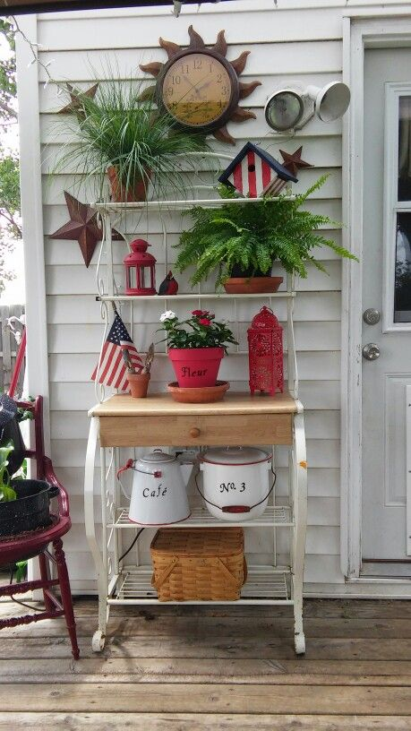 $25 bakers rack (craigslist find) outside kitchen door. I added the lettering on the red flower (fleur) pot and antique enamelware coffee (café) pot and matching lidded pot using peel and stick lettering :):