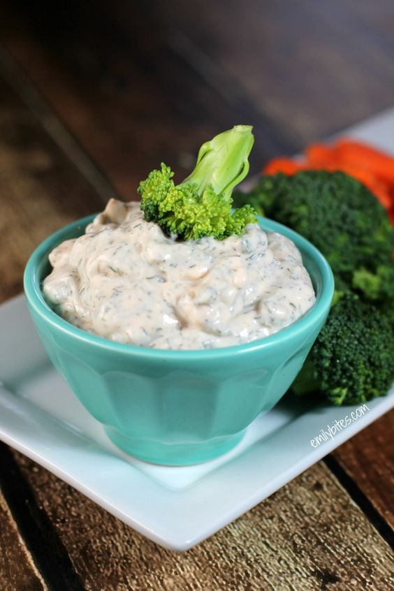 This bright, creamy Dill Dip with Greek yogurt is the perfect healthy companion for all your favorite fresh veggies. Only 39 calories or 1 Weight Watcher point per serving! www.emilybites.com