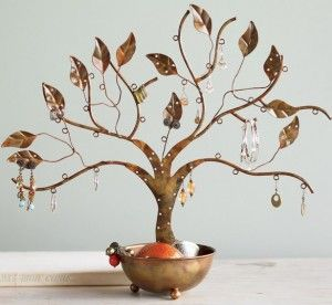 """Sustainable jewelry 'storage': Made from recycled scrap metal, this jewelry tree of life provides plenty of room to hang pieces like rings, earrings and bracelets. And the whole thing is """"rooted"""" in a large bowl that's perfect for storing larger pieces."""