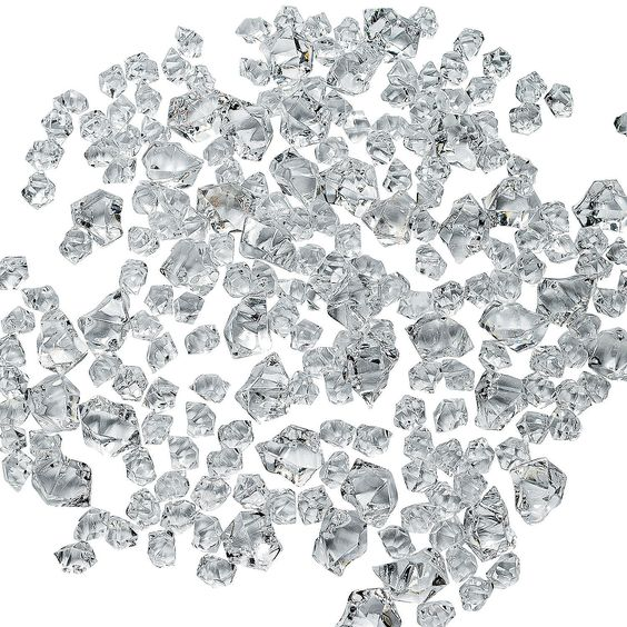 """Clear Ice. Make any centerpiece shine with these bits of faux clear """"ice"""". Sprinkle this magical acrylic ice on your wedding reception tables. (Approx. 225 pcs. per unit) 3/8"""" - 1"""""""