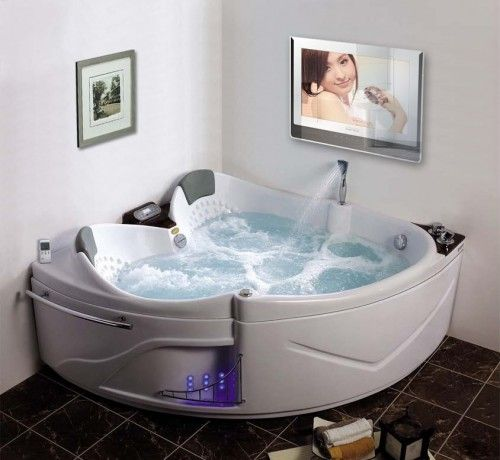 forget the water proof tv ... I think I love the tub  :)
