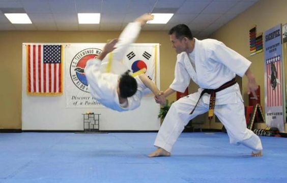 Hapkido wrist-throw - Focus, but relaxed, so grace may enter the skill
