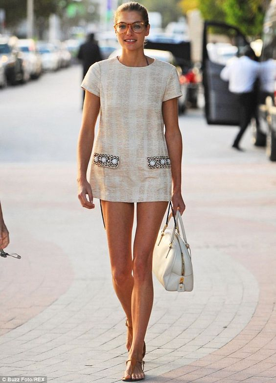 Jessica Hart took to the streets of Miami in a Tory Burch tunic with embellished pockets paired with tan sandals and a cream handbag. via dailymail.co.uk