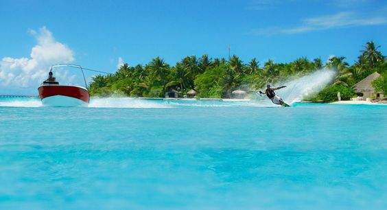 WATER SKI IN THE SHALLOW LAGOON OF A RESORT ISLAND IN MALDIVES