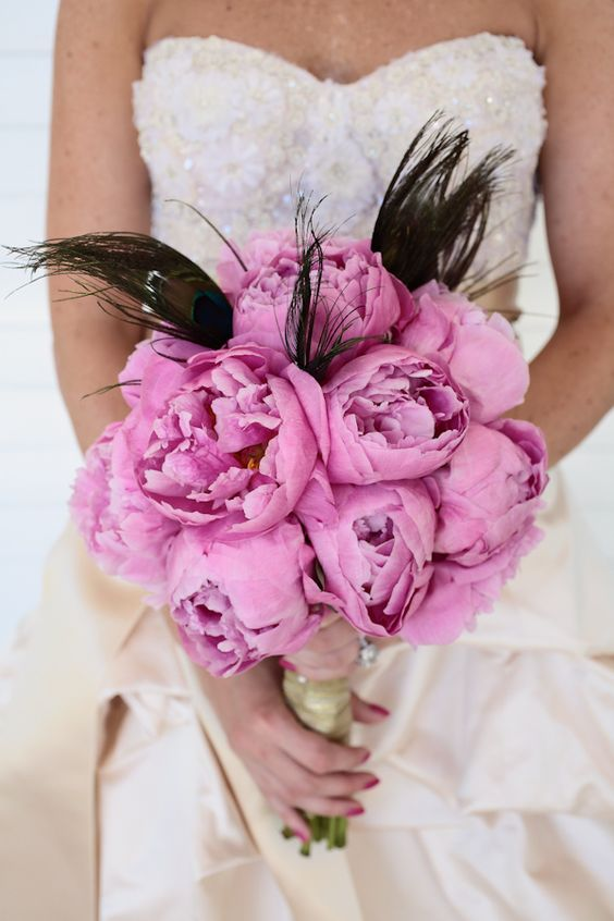 Light pink floral wedding bouquet with Peacock accents, photo by Kristin Vining Photography