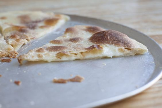 Focaccia di Recco - fluffy in the middle with a crisp crust doused in olive oil and salt flakes
