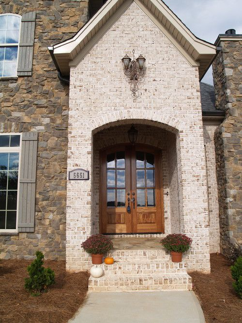 Stone and white brick exterior entranceway.