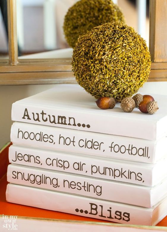 Autumn decorating idea using a stack of thrift store book and a Free Printable for fall to add to each book in the stack.
