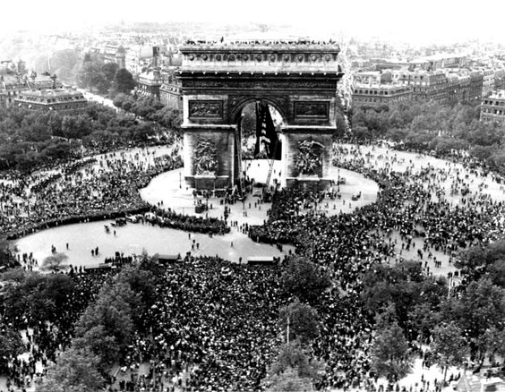 This is an aerial view of the Arc de Triomphe in Paris on VE Day, May 7, 1945, shows thousands of French people celebrating the announcement of Germany's unconditional surrender to the Allies.