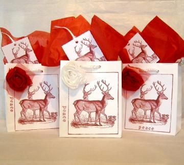 Vintage Style Raindeer on White Gift Bags, Set of Three with Fabric Flowers, & Matching Tags by Peppercorns for $7.50