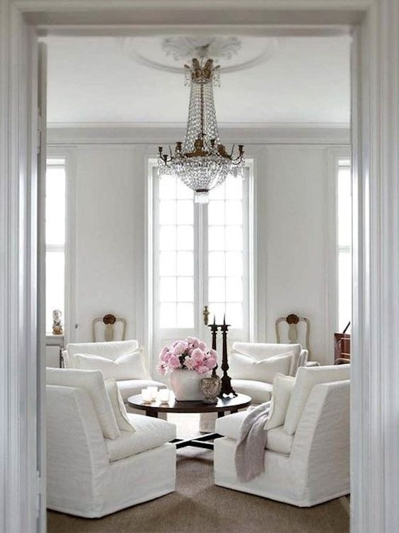 Elegant conversation area in a livin groom with Parisian style and elegant empire chandelier. Beautiful Classically Refined Rooms