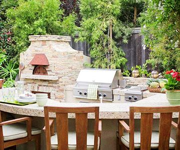 Outdoor Kitchen - full-service kitchen complete with a snack bar, dishwasher, fridge, and wood-burning pizza oven.  Can we say WOW???: Outdoorkitchen Realestate, Specialist Outdoorkitchen, Dine Outdoors, Bar Dishwasher, Outdoor Kitchens, Outdoor Room, Outdoors Kitchens, Pizza Ovens