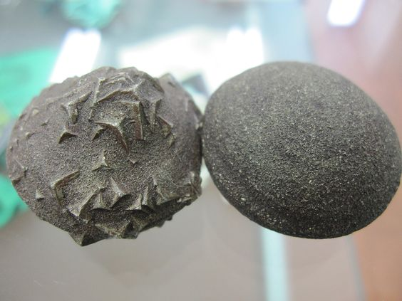 "BOJI stones (pair) - Boji Stones are actually a trademark name for iron-magnetite concretions also called Marcasite nodules. These are one of the most grounding stones with electromagnetic properties. They are most famous for their true yin and yang energies. The rougher ""male"" stones have protrusions (usually of pyrite) and ""female"" stones are smooth and unassuming. These stones have + and - charge. These ""living stones"" are used to balance the body's energy field.:"