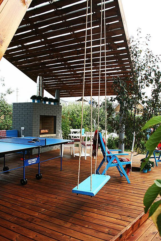 modern-outdoor-pavilion-with-fireplace-and-ping-pong-table
