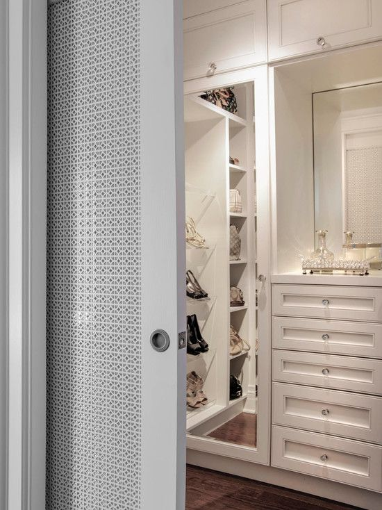 gorgeous walk in master closet with pocket slide doors with fretwork detail white picket. Black Bedroom Furniture Sets. Home Design Ideas