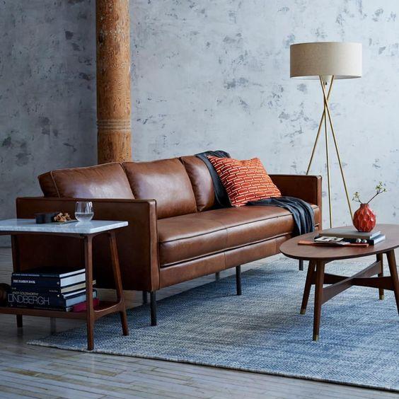 Làm mới không gian phòng khách với chi tiết nhỏ trên sofa da tphcm