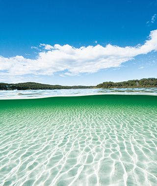 Lake McKenzie is on Fraser Island in Queensland, Australia.... The lake is located in the Great Sandy National Park. There are no more perfect puddles on earth than Lake McKenzie. To start, the impossibly snow-white sand found along its shores is made of 100 percent pure silica, a naturally occurring mineral often used in beauty products that is said to benefit hair, skin, and nails. But the lake gets more beguiling; this is the crystal-clear water that dreams are made of.