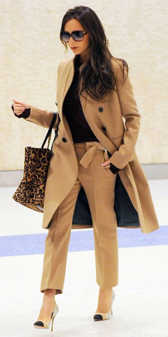 Victoria Beckham looking chic in a full camel outfit and animal print tote: