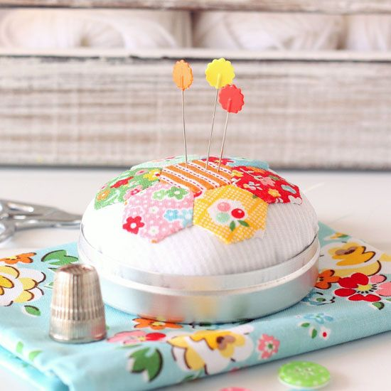 Make this colourful and fun mini Hexie Pincushion using our free sewing tutorial. Featuring a hexie flower in a metal base.