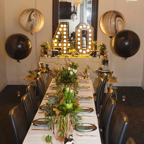 Imagine walking into this jaw dropping party styled by @missdeliciouza.  A masculine marble and copper theme 40th featuring our light uo numbers and giant marble balloons.  Perfect floral work by @inbloomfloral_design Photos captured by @abbybphotograhic