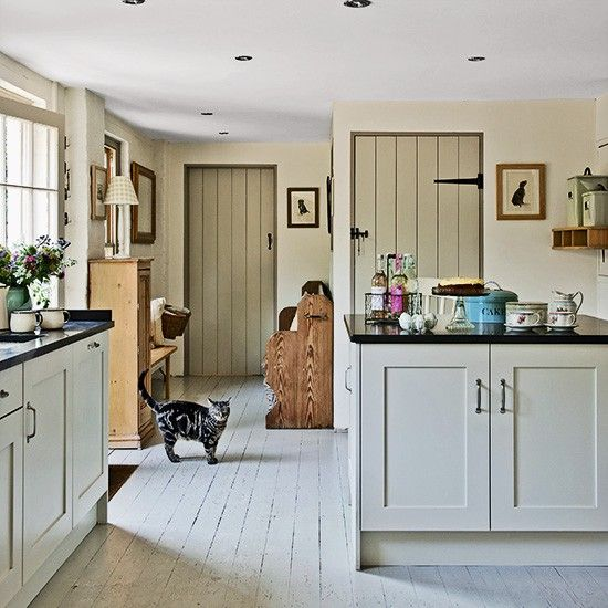 Country Homes And Interiors neutral country kitchen with painted cabinetry | georgian
