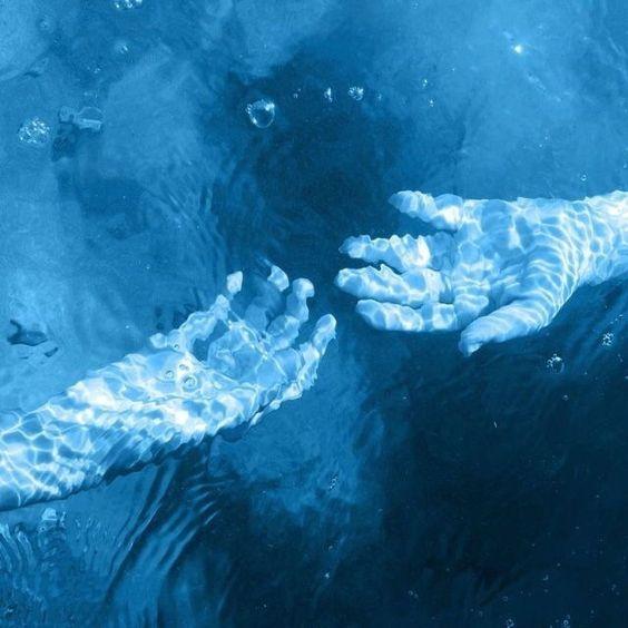 Light blue hands in a dark blue sea...