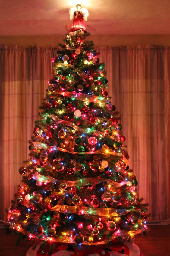 I do all white and silver, but I love the traditional multicolor on other people's trees.