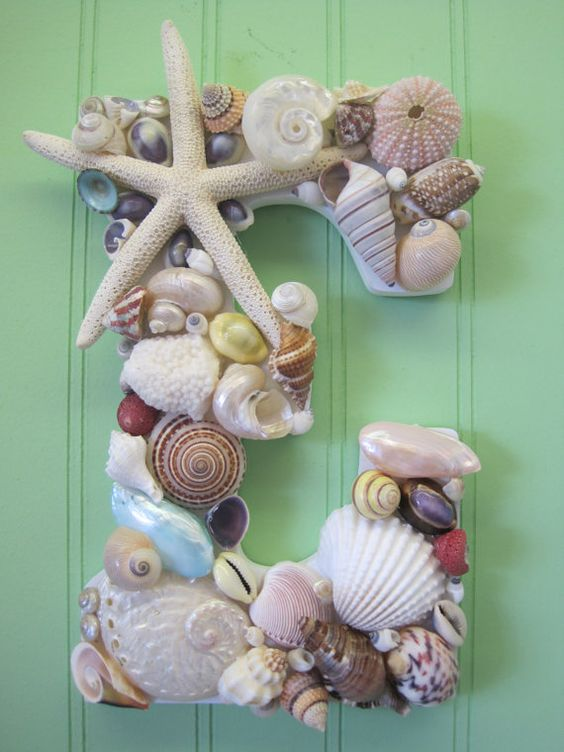 This beautiful shell encrusted wooden letter was handmade using gorgeous multi-colored shells. I used only the prettiest sea urchins, starfish,