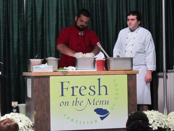 Chef Paul Donella and Nate giving cooking demonstration with local ingredients at the South Carolina State Fair