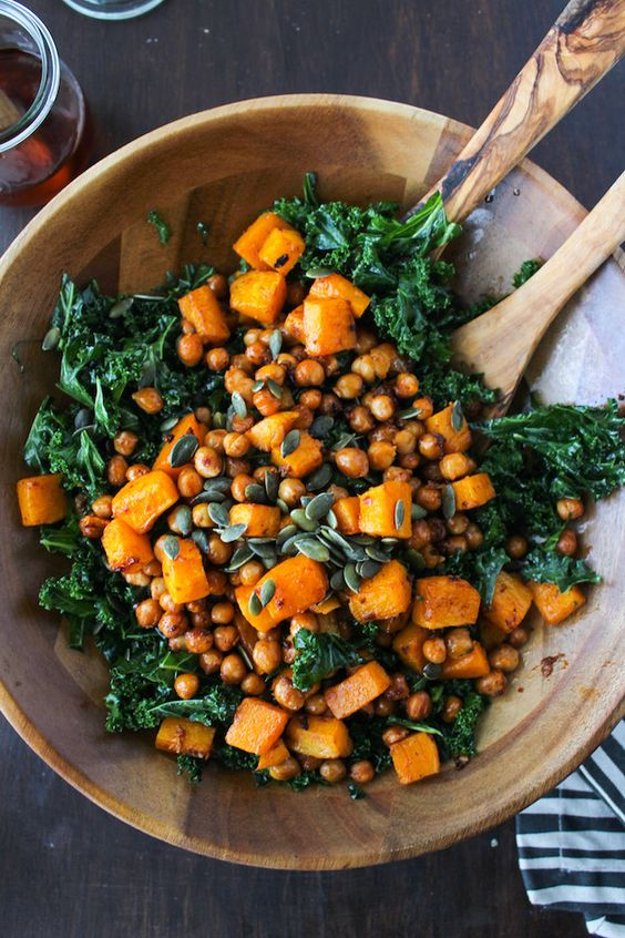 Kale, chickpea, sweet potato salad- 1 kale, cleaned and minced 1 tsp olive oil sea-salt 1 can chickpeas 1 butternut squash, peeled and diced 60 grams of pumpkin seeds For dressing: 1 teaspoon chilli sauce 4 teaspoons olive oil 1 clove of garlic 1 tsp salt 1 tsp chilli flakes 1 tbsp lime juice Mix all the ingredients for the dressing. Preheat oven to 200 degrees. Put the diced pumpkin and chickpeas in a bowl and add some chilli sauce. Mix everything up.