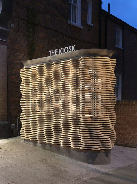 Nifty retail london flower kiosk with a wavy timber for Exterior kiosk design