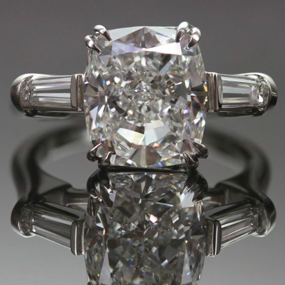 HARRY WINSTON  Diamond Platinum Engagement Ring | From a unique collection of vintage engagement rings at http://www.1stdibs.com/jewelry/rings/engagement-rings/