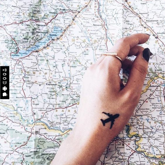 Flying aeroplane temporary tattoo sticker on wrist