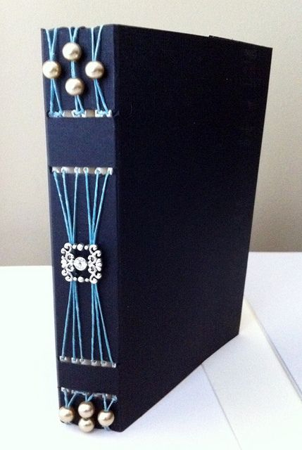 I'd like to try using old jewelry like this. #bookbinding #bookarts #longstitch: