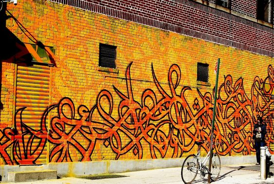 Arabic calligraphy graffiti by El Seed, NYC