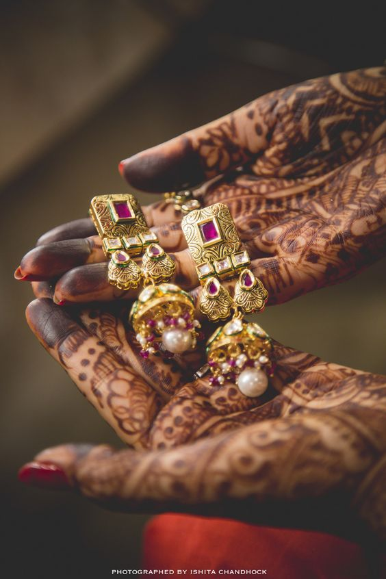 Indian Wedding Jewelry - Gold, Ruby and Polki Earings with Pearl Drops | WedMeGood | #wedmegood #indianjewelry #indianwedding #polki #ruby: