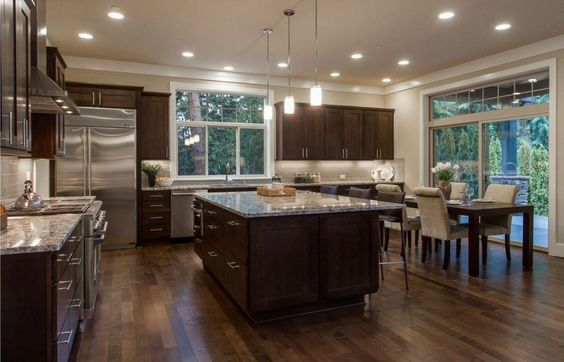 This is a darker brown cabinet but with a darker floor to go along with it. That definitely creates a great look with the granite countertops and helps lighten up the space.