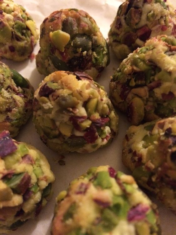 Scrumptious Mamoul - Jordanian pastries filled with dates and covered with chopped pistachios